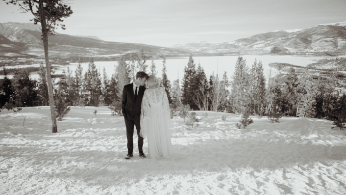 Woman and man posing in the snow black and white